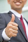 Asian businessman showing thumb up Stock Images