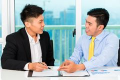 Asian businessman sign agreement Stock Photo