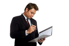 Asian businessman sign signature in a report Stock Images