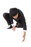 Asian businessman sit and bend down to help somebody Stock Images