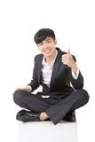 Asian businessman sit and give you an excellent sign Royalty Free Stock Images