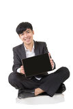 Asian businessman sit and hold pad Royalty Free Stock Photography