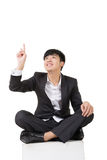 Asian businessman sit and point up Stock Image