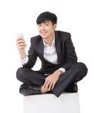 Asian businessman sit and use smart phone Stock Photography