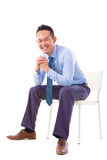 Asian businessman sitting on a chair Royalty Free Stock Image