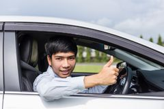 Asian businessman sitting in the modern car. For car rent or car Royalty Free Stock Image