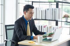 Free Asian Businessman Sitting Work In Office Workplace Stock Photography - 211899322