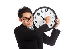 Asian businessman smile move clock arm Stock Images