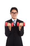 Asian businessman smile with red dumbbells Royalty Free Stock Images