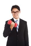 Asian businessman smile with red dumbbells Royalty Free Stock Photography