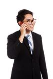 Asian businessman smile  talk on mobile phone Royalty Free Stock Image