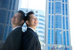 Asian businessman smiling in the city Stock Photos