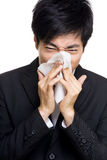 Asian businessman sneezes Stock Image