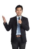 Asian businessman speaking with microphone. Isolated on white background Stock Images