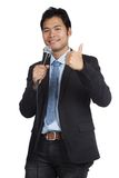 Asian businessman speaking with microphone show thumbs up. Isolated on white background Stock Images
