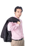 Asian businessman stands with his jacket over his shoulder, isol Royalty Free Stock Photos