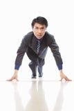 Asian businessman start to run Stock Photos