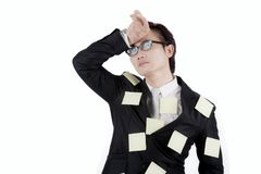 Asian businessman with sticky notes on studio Stock Photography
