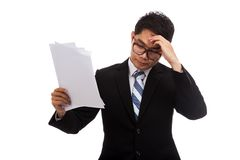 Asian businessman stressed with  report paper Stock Photos