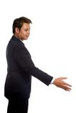 Asian businessman in suit offering to shake the hand Royalty Free Stock Photo
