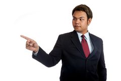 Asian businessman in suit point to the right Royalty Free Stock Image