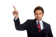 Asian businessman in suit point up look at camera Royalty Free Stock Images