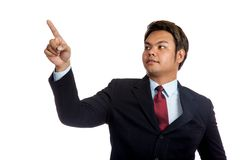 Asian businessman in suit point up and look up Stock Images