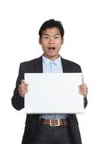 Asian businessman surprise with a blank sign Stock Image