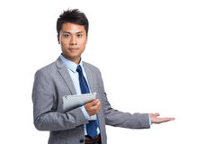 Asian businessman with tablet and open hand palm Stock Image
