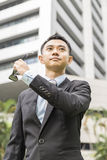 Asian Businessman take off his sunglasses his sunglasses Royalty Free Stock Photos