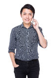 Asian businessman talk to cellphone Royalty Free Stock Photo