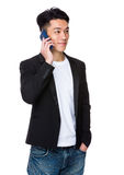 Asian businessman talk to cellphone Stock Images