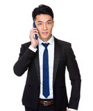 Asian Businessman talk to cellphone Stock Photos