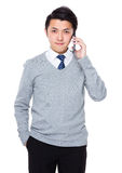 Asian businessman talk to cellphone Royalty Free Stock Image