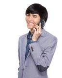 Asian businessman talk to mobile phone Stock Photo