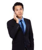 Asian Businessman talk to mobile phone Royalty Free Stock Photos