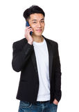 Asian businessman talk to mobile phone Royalty Free Stock Image