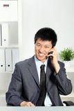 Asian Businessman Talking on Cellphone Royalty Free Stock Image