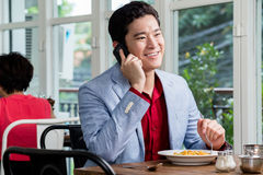 Asian businessman talking on his mobile Stock Image