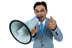 Asian businessman talking through megaphone. On withe background Stock Images