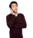 Asian businessman talking on mobile cell phone Stock Images