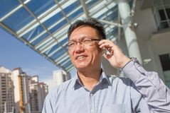 Asian businessman talking on the phone Stock Photography