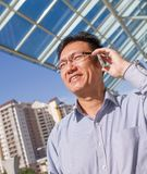 Asian businessman talking on the phone Royalty Free Stock Images