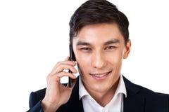 Asian businessman talking on phone Royalty Free Stock Photo