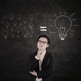 Asian businessman think of big idea. With lightbulb background Royalty Free Stock Photography