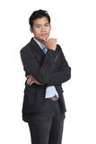 Asian businessman is thinking look at camera Royalty Free Stock Photography