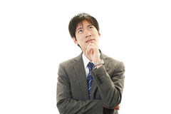 Asian businessman thinking Royalty Free Stock Images