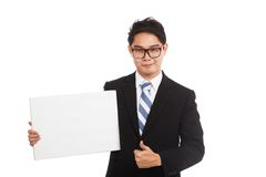 Asian businessman  thumbs up with  blank sign and smile Stock Photography