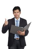 Asian businessman thumbs up with a folder Stock Photo