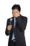 Asian businessman to shy to speak close his face Royalty Free Stock Photo